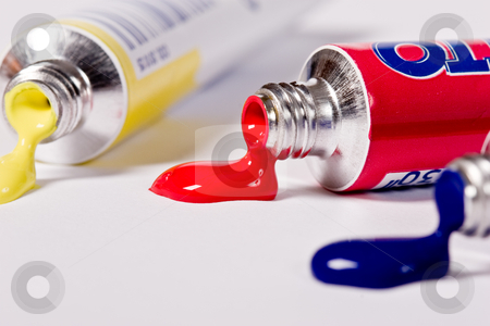Tube of Paint stock photo, Open tube of blue , red and yellow paint by Gennady Kravetsky