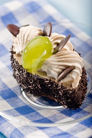 Fancy cake stock photo, Chocolate fancy cake with cream and grape by Gennady Kravetsky