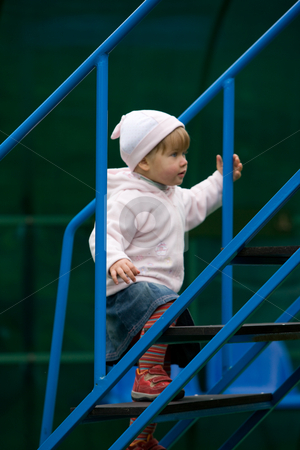 Little girl stock photo, People series: little girl get up on stairs by Gennady Kravetsky