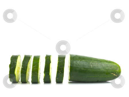 Sliced Cucumber stock photo, Green Sliced Cucumber on a white Background by John Teeter