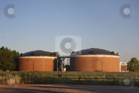 Biotowers of water reclamation plant stock photo, Two brick round biotower structures at water reclamation facility, Fort Collins, Colorado by Marek Uliasz