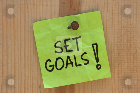 Set goals - motivational reminder stock photo, Set goals - motivational reminder on post note nailed to wooden plank or wall by Marek Uliasz