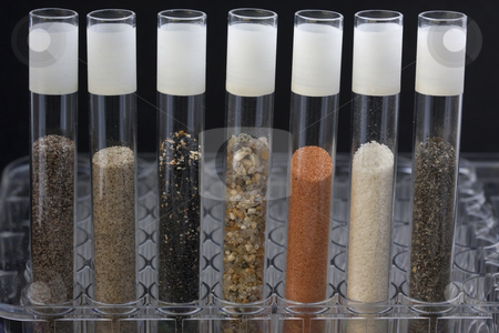 Sand in laboratory testing tubes stock photo, Science abstract - glass testing tubes with different sand samples collected from beaches and deserts of western USA and Hawaii by Marek Uliasz