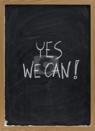 Yes we can - motivational slogan on blackboard stock photo, Yes we can - motivational slogan handwritten with white chalk on blackboard with eraser smudges by Marek Uliasz