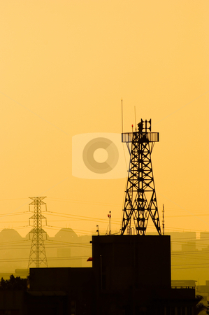 Base station of cell phone, wireless communication. stock photo, Base station of cell phone under sunset, wireless communication. by Lawren