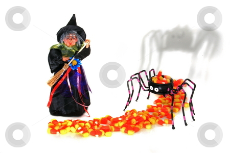 Halloween Witch stock photo, Halloween witch sweeping candy on to spider bowl by Jack Schiffer