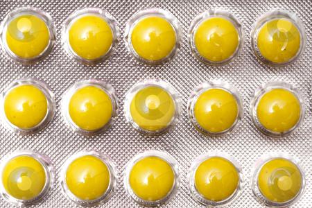 Yellow Pills stock photo, Package of Yellow Pills by Ingvar Bjork