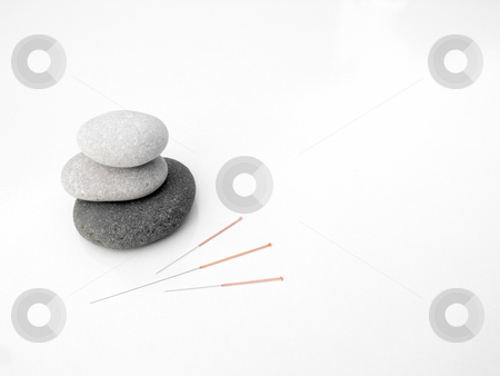 Acupuncture needles concept of zen and earth stock photo, Acupuncture needles displayed with stacked stones by Chris Clews