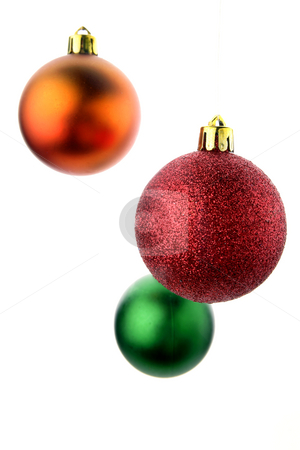 Christmas baubles    stock photo, Three Christmas baubles isolated over white background. by Les Cunliffe
