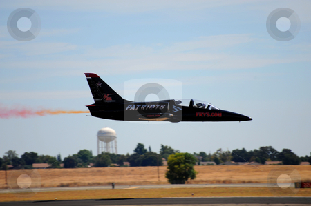 L-39 Jet At Airshow stock photo, Patriots Jet Team L-39 jet doing a low level flyby at the California Capital Airshow in Sacramento at Mather Field on September 13th 2009 by Lynn Bendickson