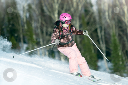 Girl riding on skis stock photo, Girl riding fast on skis by Peter Kirillov