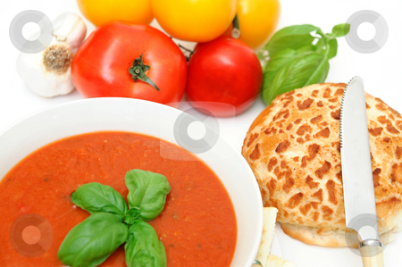 Tomatoes And Tomato Soup stock photo, Bowl of tomato soup with crackers and a roll with  fresh tomatoes isolated on a white background by Lynn Bendickson
