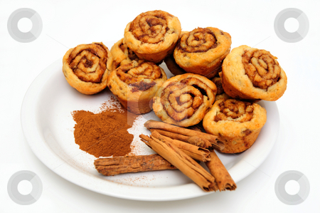 Cinnamon Rolls stock photo, Powdered and stick cinnamon with freah baked mini cinnamon rolls on a white plate by Lynn Bendickson