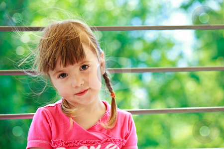 Little girl with two plaits stock photo, Little girl with two plaits and pink t-shirt on a green background by Natalia Macheda