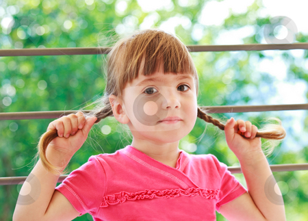 Little girl with two plaits stock photo, Little funny girl holding her two plaits by Natalia Macheda