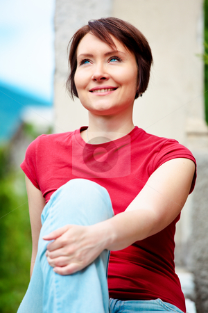 Positive woman outdoors stock photo, Positive young woman outdoors looking up with smile by Natalia Macheda