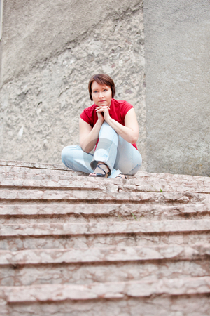 Pensive young woman stock photo, Modern young woman thinking on ancient staircase by Natalia Macheda
