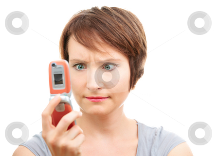 Angry woman with phone stock photo, Angry woman reading message on her cell-phone isolated on white by Natalia Macheda