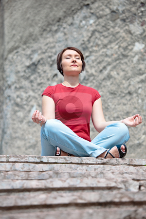 Drawing energy from sacred places stock photo, Modern yong woman meditation among ancient sacred buldings by Natalia Macheda