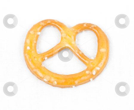 Pretzel on white canvas stock photo, Crunchy snacky pretzel with salt on white canvas by Natalia Macheda