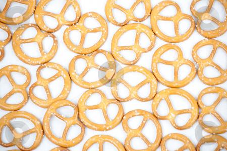Pretzel pattern stock photo, Pattern of crunchy snacky pretzels with salt on white canvas by Natalia Macheda