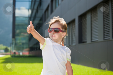 Happy child with sunglasses stock photo, Happy child with sunglasses showing thumb-up by Natalia Macheda