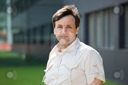 Modern middle-aged man stock photo, Portrait of a modern middle-aged man with a building on the background by Natalia Macheda