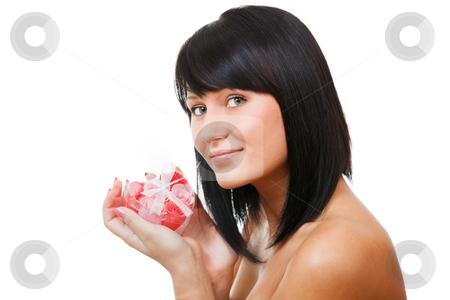 Sexy brunette holding gift-box stock photo, Sexy brunette holding gift-box in the form of heart isolated on white background by Natalia Macheda