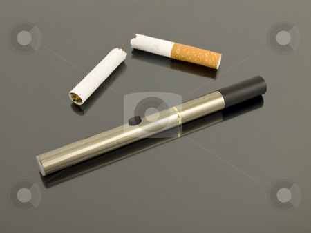 Electronic cigarette with broken cigarette stock photo, Electronic cigarette with broken analog cigarette by John Teeter