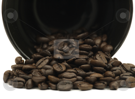 Coffee Cup spilling beans stock photo, Close up of coffee mug spilling beans on a white background by John Teeter