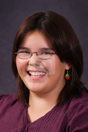 10 Year Old Portrait stock photo, A 10 year old girl smiling for her school portrait by Richard Nelson