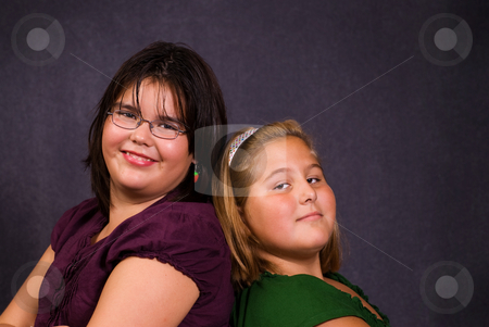 Friendship stock photo, Two best friends leaning against each other back to back by Richard Nelson