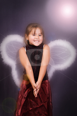4 Year Old Angel stock photo, A young girl dressed in wings pretending to be an angerl by Richard Nelson