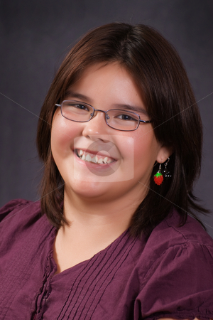 School Portrait stock photo, A 10 year old girl smiling for her school portrait by Richard Nelson