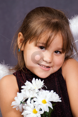Cute Child stock photo, Closeup view of a young girl holding some artificial daisies by Richard Nelson