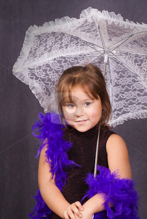 Cute Portrait stock photo, A four year old girl holding a lace umbrella getting her portrait done and wearing a feather boa by Richard Nelson