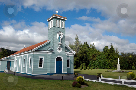 Wooden countryside church stock photo, Exterior of wooden church building in landscaped gardens and countryside. by Martin Crowdy