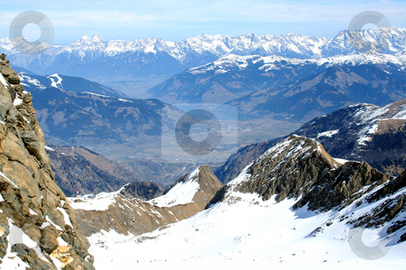 Alps mountains landscape stock photo, Aerial view of Swiss Alps mountains looking down to village in valley. by Martin Crowdy