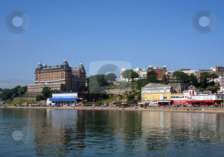 Arcade amusements by beach stock photo, Scenic view of arcade amusements on waterfront with beach and ocean in foreground, Scarborough, North Yorkshire, England. by Martin Crowdy