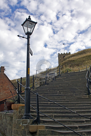 199 Steps Whitby stock photo, Low angle view of 199 steps leading up to Saint Marys Church and Whitby Abbey, North Yorkshire, England. by Martin Crowdy