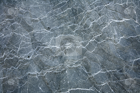 Gray granite stone texture surface worn by the sea. stock photo, Gray granite stone texture surface worn by the sea. by Stephen Rees