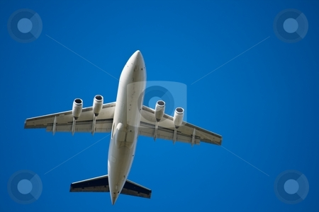Jet airliner against blue sky stock photo, Jet airliner against blue sky by Interlight