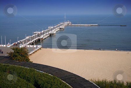 Pier and Beach in Sopot stock photo, The wooden pier and beach in Sopot, Pomerania. by Interlight