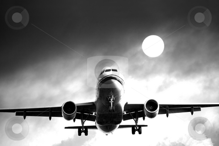 Jet airliner against cloudy sky stock photo, Jet airliner against cloudy sky by Interlight