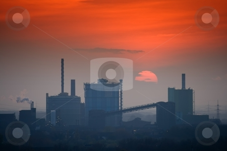 Industrial skyline at sunset stock photo, Industrial skyline with the setting Sun by Interlight