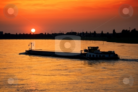 Barge with cargo at sunset stock photo, Barge with cargo at sunset by Interlight
