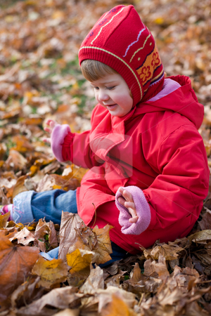 Golden  autumn stock photo, People series: little girl play with leaf by Gennady Kravetsky