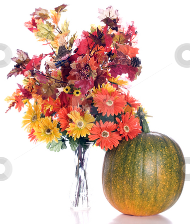 Autumn Flowers stock photo, Artificial fall flowers and leaves shot next to a real pumpkin that is slowly turning orange, isolated against a white background by Richard Nelson