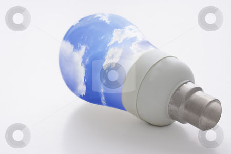 Light bulb and blue sky stock photo, Low energy consumption light bulb with blue sky as bulb. Concept for clean, green sustainable energy and energy consumption. Isolated on white background by Gabriele Mesaglio