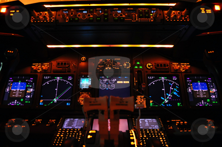 Flight deck stock photo, Instrument panel of a modern airliner at night (Boeing 737-800 Next Generation). by Fernando Barozza